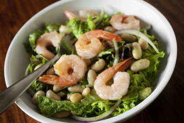 simple shrimp salad on greens with green dressing