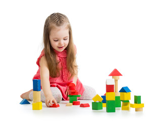 kid girl playing with block toys