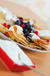 sweet  pancakes with berries and dairy cream