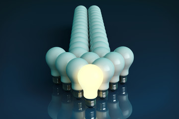 Leadership concept. One glowing light bulb standing in front of
