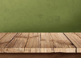 Wooden table and green background wall