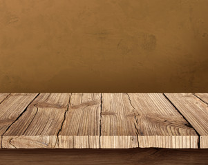 Wooden table and brown background wall