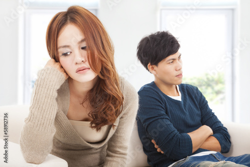 young Couple sitting on the sofa  during  conflict