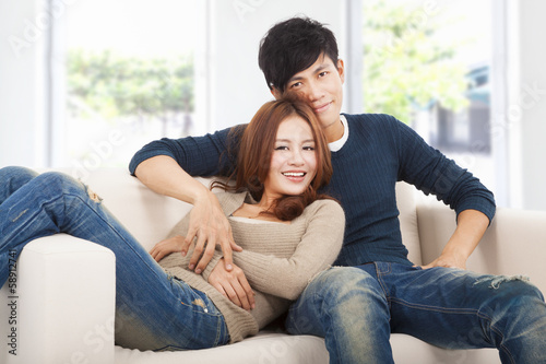 happy Couple in sofa  at home