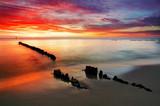 Fototapety Poland, Ocean sunset on beach.