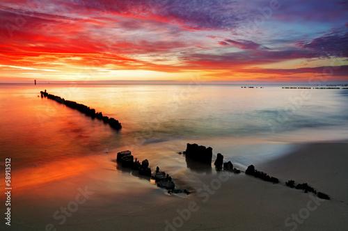 Poland, Ocean sunset on beach. - 58913512