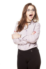 shocked young business woman with crossed arms