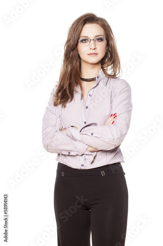 young serious business woman posing with crossed arms
