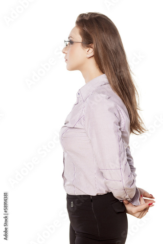 side view of young businesswoman in shirt and trousers