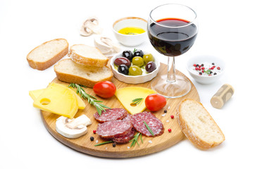 salami, cheese, bread, olives, tomatoes and glass of red wine