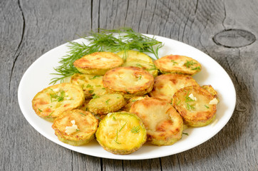 Fried zucchini with dill