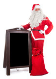 Santa Claus standing beside advertising board