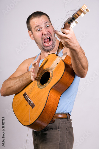 man with broken guitar
