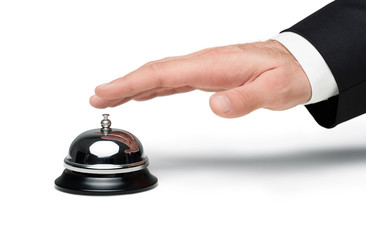 businessman's hand pressing a service bell isolated on white