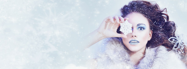 Winter snow queen - woman with snowflake