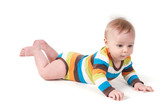 Cute kid in a striped body lying on his tummy