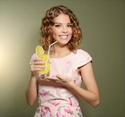 Girl with fresh lemonade
