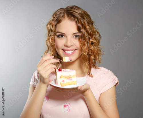 Smiling girl with piece of cake