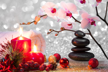 massage composition christmas spa with candles, orchid, stones