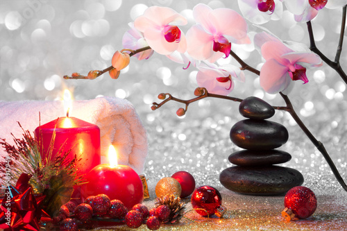 Foto op Aluminium Ontspanning massage composition christmas spa with candles, orchid, stones