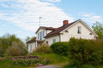 White wooden cottage, Sweden