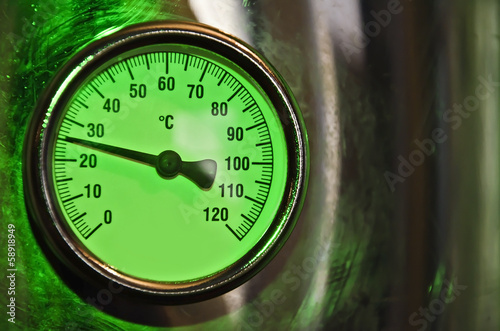 temperature gauge with a shiny metallic frame