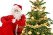 Weihnachtsmann greift in seine Tasche