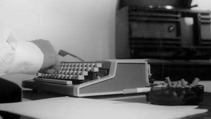 Reporter typing on a vintage typewriter