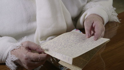 Senior woman lives on memories reading old letters