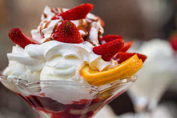 Delicious vanilla sundae with strawberry