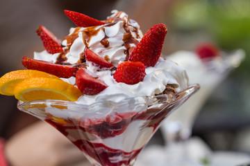 Delicious vanilla sundae with strawberry