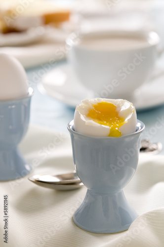 Breakfast table with soft-boiled egg.