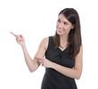Lachende junge Geschäftsfrau isoliert zeigt auf etwas isoliert