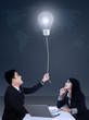 Businesspeople getting a bright idea