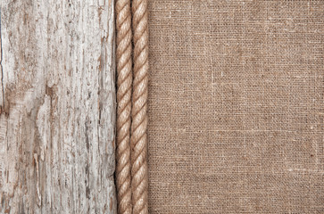 Burlap background bordered by rope and old wood