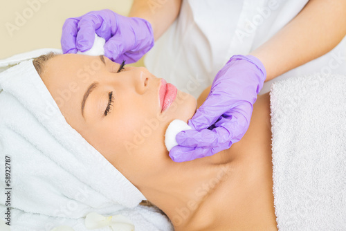 Young woman receiving beauty therapy