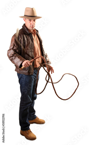 Adventurer treasure hunter is swinging with bull whip