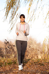 Woman jogging outdoors. Healthy lifestyle concept.