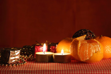 Still life with the candle and mandarin.