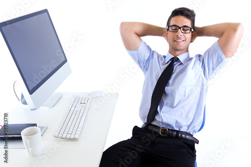 Happy young business man relaxing  in  office