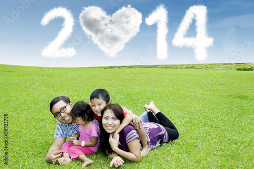 Happy family under cloud of new year 2014