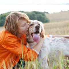 woman with dog (Irish setter) outdoors