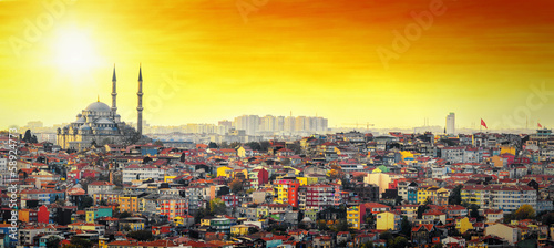 Poster Turkey Istanbul Mosque with colorful residential area in sunset