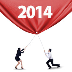 Teamwork pulling the banner of new year of 2014