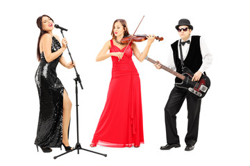 Full length portrait of a band of young musicians