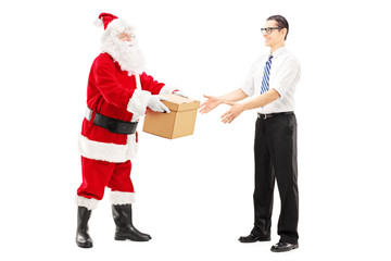 Santa Claus giving a box to a young male