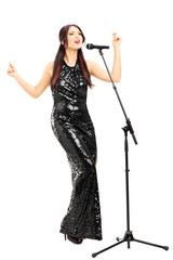 Attractive woman in black dress singing