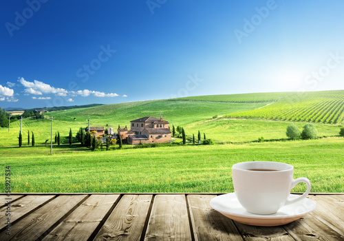cup coffee and tuscany landscape, Italy