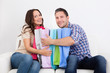 Excited Couple With Shopping Bag