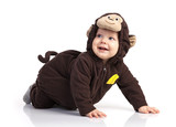 Cute baby boy in monkey costume looking up over white